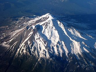 Mount Shasta - Aerial view of Mount Shasta from the southwest, with sun low in the west