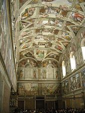 A tall, narrow room with a highly detailed painted ceiling depicting Bible scenes