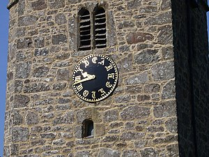 Buckland-in-the-Moor - Detail of the clock face.