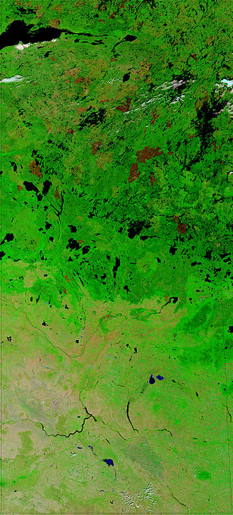 Geography of Saskatchewan - NASA image of Saskatchewan and a portion of Manitoba. Dark to light rust coloured areas in the north are burn scars from forest fires