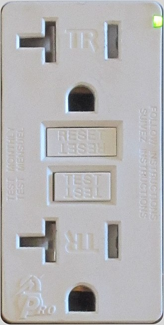"Residual-current device - A Leviton GFCI ""Decora"" receptacle in a North American kitchen. Local electrical code requires tamper-resistant receptacles in homes, and requires a GFCI for receptacles within 1 metre of a sink. The T-slot indicates this device is rated 20 A and can take either a NEMA 5-15 or a NEMA 5-20 plug, though the latter type is rare on household appliances."