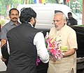 Narendra Modi being received by the Minister of State for Urban Development, Housing and Urban Poverty Alleviation, Shri Babul Supriyo, on his arrival at launching ceremony of the Smart Cities Mission.jpg