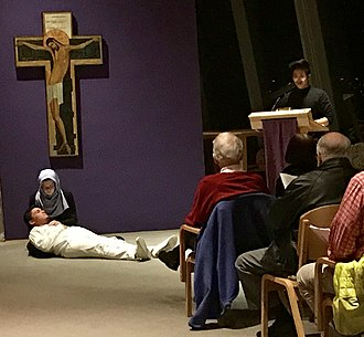"Newman Centers - Similar to the ""Pieta"",  the University of Nevada Reno Our Lady of Wisdom Newman Center students acting out the Stations of the Cross during Lent at the Carmel of Reno."