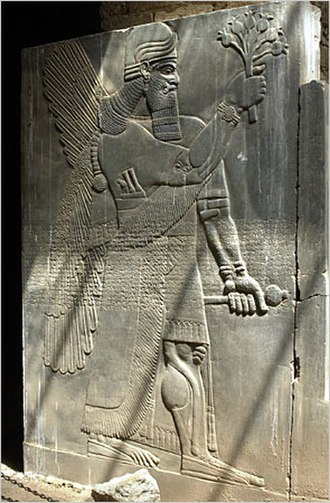 Ceremonial mace - Ceremonial mace (left hand) depicted on stela from Nimrud