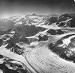 North Trimble Glacier, junction of valley glacier, wave ogives, icefall, and bergschrund, August 26, 1969 (GLACIERS 6450).jpg