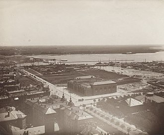 Kalvebod Brygge - The Timber Dock and lumberyards seen to the right with the newly built Ny Carlsberg Glyptotek and H. C. Andersens Boulevard in the foreground, c. 1897