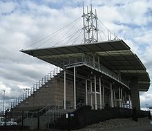 Hillsboro Stadium has a main grandstand built of concrete with a metal roof suspended by cable attached to several towers.