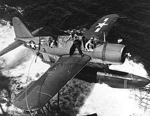 OS2U-3 Kingfisher is recovered by USS Baltimore (CA-68) off Truk on 18 February 1944 (80-G-218123).jpg