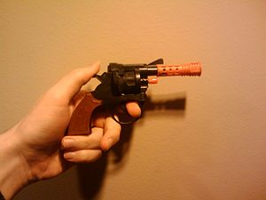 Toy weapon - A modern cap gun, its barrel made from bright orange plastic to prevent it from being mistaken for a real gun