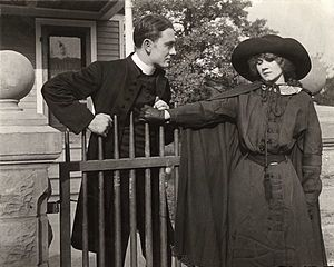 Owen Moore - Owen Moore with Florence Lawrence in a scene still from a silent drama, possibly The Redemption of Riverton (1912)