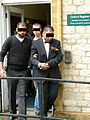 Oxford sham marriage - Groom is led away in handcuffs.jpg