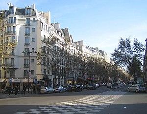 Arab Congress of 1913 - Boulevard Saint-Germain at the corner of Rue de Buci. Buildings shown between the corner of the rue de Buci and rue de Seine are the original North side of the former rue des Boucheries.