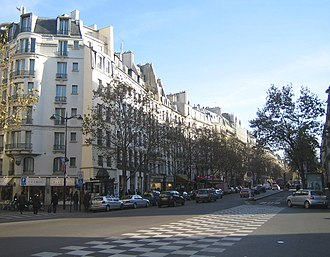 Arab Congress of 1913 - Boulevard Saint-Germain at the corner of Rue de Buci. Buildings shown between the corner of the rue de Buci and rue de Seine are the original North side of the former rue des Boucheries.
