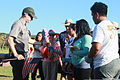 Park Ranger Ben Hayes, far left, passes out United States flags to volunteers for building a flag display for Memorial Day, Asan Beach, Guam, May 25, 2013 130525-M-BC209-011.jpg
