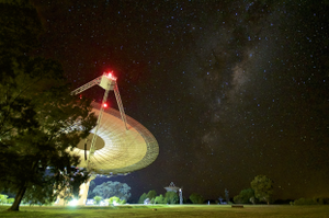 Parkes Observatory - The Parkes observatory is positioned to be isolated from radio frequency interference. The site also sees dark skies in optical light, as seen here in June 2017 with the Milky Way Galaxy overhead.