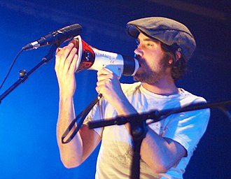 Patrick Watson (musician) - Watson singing through a megaphone, used to warp and loop his voice, during a performance in 2009.