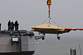 Personnel load a U.S. Navy X-47B Unmanned Combat Air System demonstrator aircraft onto the flight deck of the aircraft carrier USS George H.W. Bush (CVN 77) in Norfolk, Va., May 6, 2013 130506-N-CZ979-045.jpg