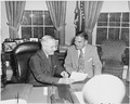 Photograph of President Truman conferring in the Oval Office with the man he defeated in the 1948 presidential... - NARA - 200323.tif