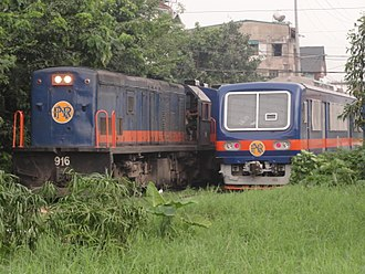 PNR Metro South Commuter Line - A PNR 900 class locomotive and a Hyundai Rotem DMU