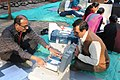 Polling officials checking the Electronic Voting Machine (EVM) and other necessary inputs required for the Gujarat Assembly Election, at the distribution centre, at Athawa Gate line, in Surat, Gujarat on December 08, 2017.jpg