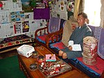 Postal agent of Bitekha Community Mail Office in 2008 at home with postal paraphernalia.jpg
