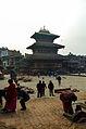 Pujas across one of Bhaktapur's pagodas (12678516173).jpg