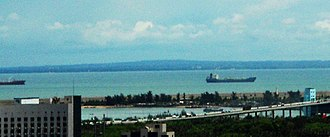 Leizhou Peninsula - The Leizhou Peninsula viewed from Haikou City, Hainan over the Qiongzhou Strait.