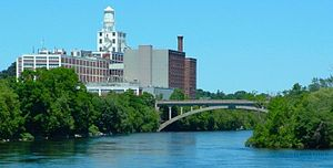 Peterborough, Ontario - The Quaker Oats factory on the edge of the Otonabee River, with the Hunter Street bridge