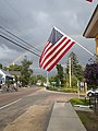 Rainbow over VT Rte 114 American flag downtown East Burke VT August 2019.jpg
