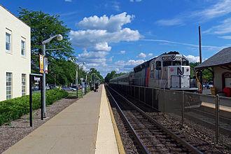 Main Line (NJ Transit) - A Main Line train led by a GP40PH-2 at Ramsey station.