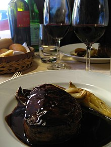 Red meat and a glass of red wine