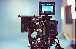 A photograph of the Red EPIC camera, with its output screen unfolded.