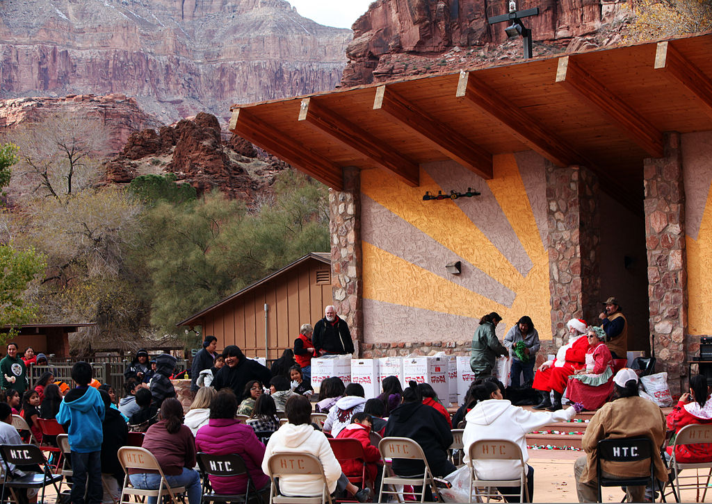 Richard E. McCallum, background right, a Northern Arizona Toys for Tots coordinator, portrays Santa Claus while toys are distributed to children in Supai Village, Ariz., Dec. 14, 2011 111214-M-QX735-394