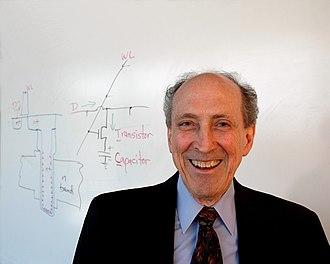 Robert H. Dennard - Dr. Robert H. Dennard, IBM Fellow, beside his drawing of a DRAM cell (circuit schematic)