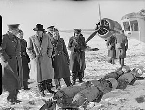 Harold Balfour, 1st Baron Balfour of Inchrye - During the Second World War, the Under-Secretary of State for Air, H H Balfour, questions an Air Commodore about 250-lb GP bombs, which are about to be loaded into a Bristol Blenheim Mark IV of the Advanced Air Striking Force on a snow-covered airfield in France.