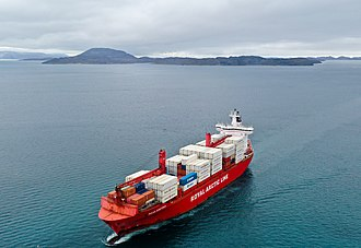 Royal Arctic Line operates cargo freight services by sea from, to and across Greenland. Royal Arctic Line ship Naja Arctica near Nuuk (Quintin Soloviev).jpg