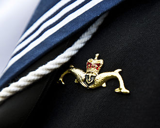 "Royal Navy Submarine Service - The ""Dolphins"" badge, issued to all British submariners on completion of training. It is worn on the upper left breast, just above any medal ribbons."