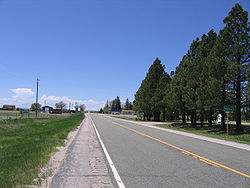 Looking west down Highway 94, Pikes Peak is in the distance