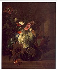 Flowers in a glass vase on a balustrade with colonnade