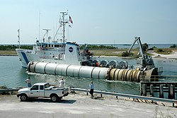 Solid rocket booster of the STS-114 mission being recovered and transported to Cape Canaveral.