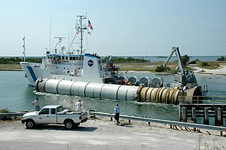 Port Canaveral - The rocket booster recovery ship Freedom Star with a spent solid rocket booster (SRB) from the STS-114 launch in tow as it makes it way through Port Canaveral.
