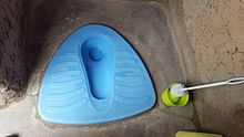 A counterweight slab toilet installed in Rwanda.
