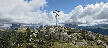 Summit cross on the Raschötz mountain in Gröden