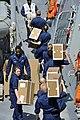 Sailors aboard USS Jason Dunham sow supplies. (8560362284).jpg