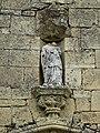 Saint-Sulpice-d'Excideuil église statue au-dessus portail.jpg