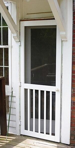 Storm door - residential wood and mesh screen door, USA