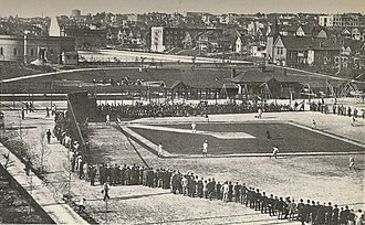 Cal Anderson Park - Baseball at Lincoln Park circa 1919. The open-air Lincoln Reservoir is visible in the near background. The building at left still exists today, as does the German United Church of Christ at right. The water tower on the horizon is in Volunteer Park.