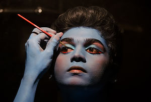 Cosmetics - An artist applying make-up for an Indian classical dance