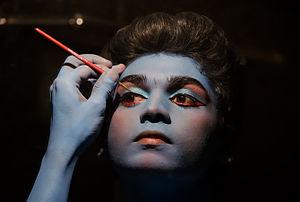 Cosmetics - An artist applying make-up for an Indian classical dance