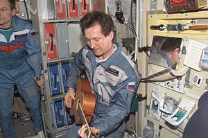 Sergei Treshchov - Sergei Treshchov plays a guitar in the ''Zvezda'' Module on the ISS.